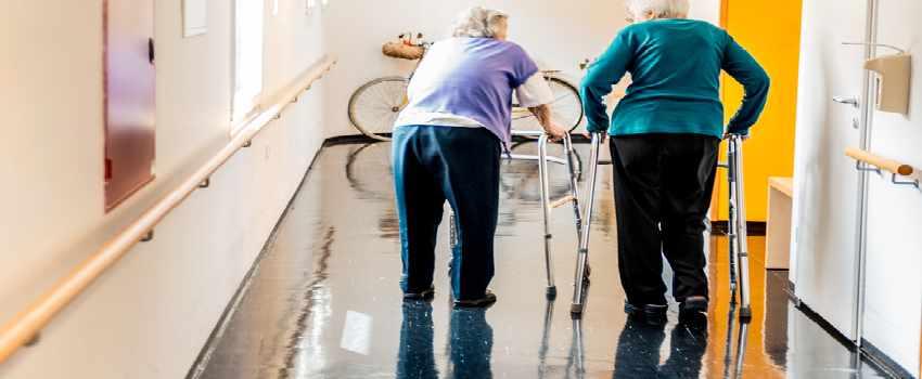 Seniors Walking In Nursing Home